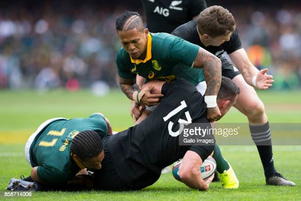 Ryan Crotty of New Zealand Elton Jantjies and Courtnall Skosan of the Springbok Team during the Rugby Championship 2017 match between South Africa...