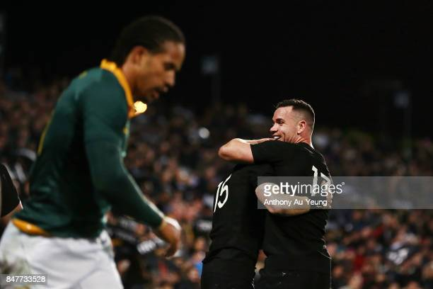 Ryan Crotty of the All Blacks celebrates with teammates Damian McKenzie after a try from Nehe MilnerSkudder during the Rugby Championship match...