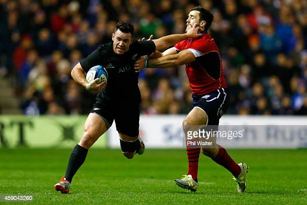 Ryan Crotty of the All Blacks is tackled by Alex Dunbar of Scotland during the Viagogo Autumn International match between Scotland and New Zealand at...