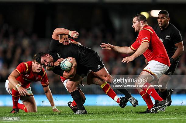 Ryan Crotty of the All Blacks is tackled during the International Test match between the New Zealand All Blacks and Wales at Eden Park on June 11...