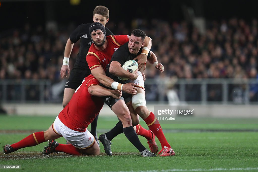 <a gi-track='captionPersonalityLinkClicked' href=/galleries/search?phrase=Ryan+Crotty&family=editorial&specificpeople=4252951 ng-click='$event.stopPropagation()'>Ryan Crotty</a> of the All Blacks is tackled during the International Test match between the New Zealand All Blacks and Wales at Forsyth Barr Stadium on June 25, 2016 in Dunedin, New Zealand.