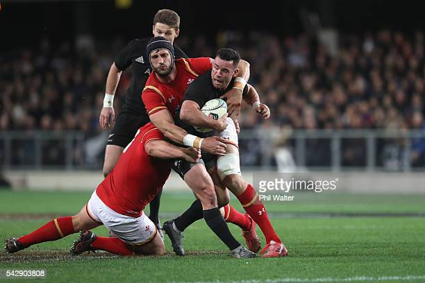 Ryan Crotty of the All Blacks is tackled during the International Test match between the New Zealand All Blacks and Wales at Forsyth Barr Stadium on...