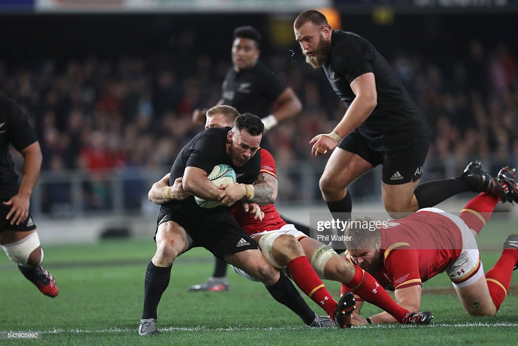 Ryan Crotty of the All Blacks is tackled during the International Test match between the New Zealand All Blacks and Wales at Forsyth Barr Stadium on June 25, 2016 in Dunedin, New Zealand.