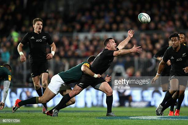 Ryan Crotty of the All Blacks looses the ball in a tackle during the Rugby Championship match between the New Zealand All Blacks and the South Africa...