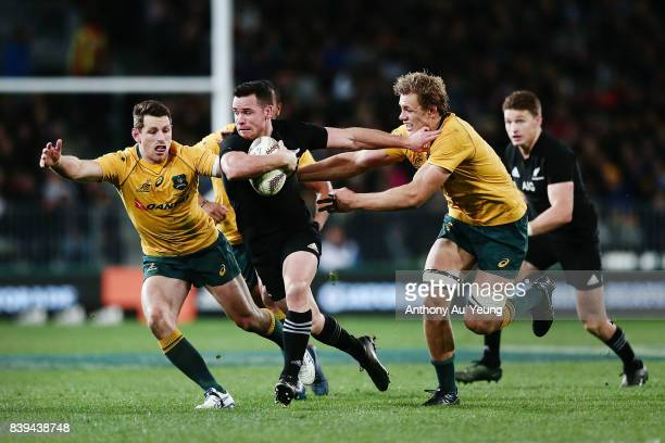 Ryan Crotty of the All Blacks on the charge against Ned Hanigan and Bernard Foley of the Wallabies during The Rugby Championship Bledisloe Cup match...
