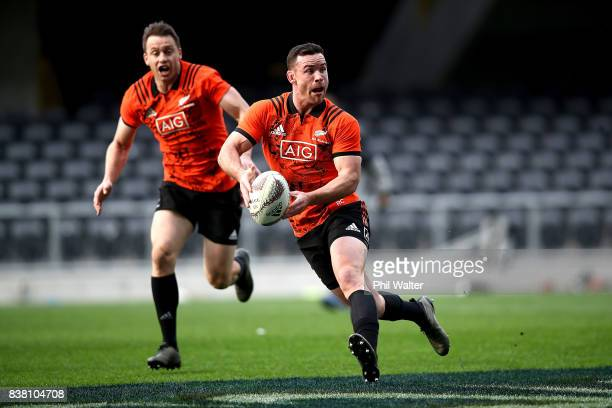 Ryan Crotty of the All Blacks passes during a New Zealand All Blacks training session at Forsyth Barr stadium on August 24 2017 in Dunedin New Zealand