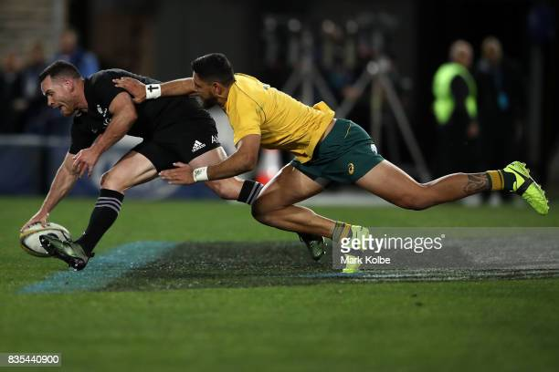 Ryan Crotty of the All Blacks scores a try under pressure from Curtis Rona of the Wallabies during The Rugby Championship Bledisloe Cup match between...