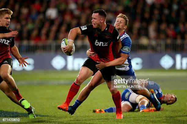 Ryan Crotty of the Canterbury Crusaders looks to pass in a tackle during the Super Rugby match between New Zealand's Canterbury Crusaders and South...