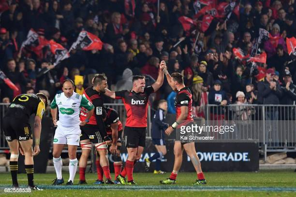 Ryan Crotty of the Crusaders and his teammates reacting after their win in the round 12 Super Rugby match between the Crusaders and the Hurricanes at...