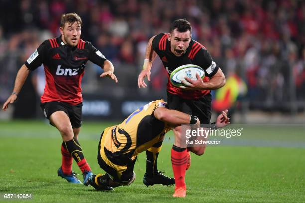 Ryan Crotty of the Crusaders charges forward during the round five Super Rugby match between the Crusaders and the Force at AMI Stadium on March 24...