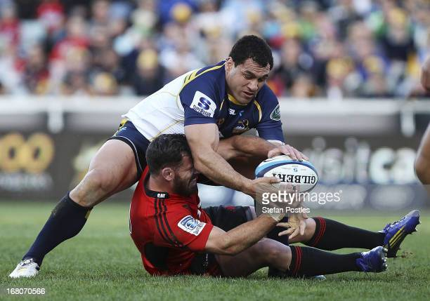 Ryan Crotty of the Crusaders is tackled during the round 12 Super Rugby match between the Brumbies and the Crusaders at Canberra Stadium on May 5...