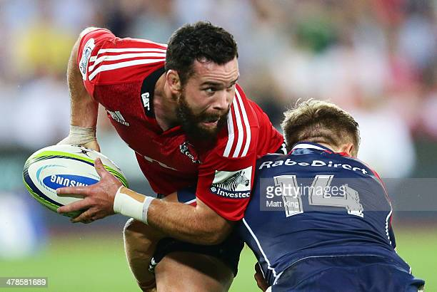 Ryan Crotty of the Crusaders is tackled during the round five Super Rugby match between the Melbourne Rebels and the Crusaders at AAMI Park on March...