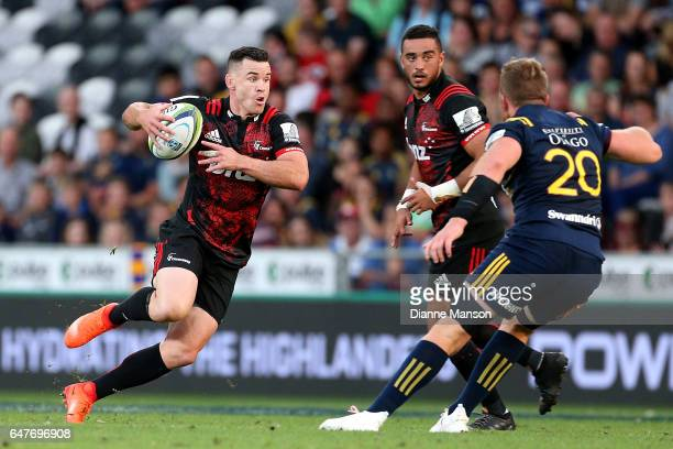 Ryan Crotty of the Crusaders makes a break during the round two Super Rugby match between the Highlanders and the Crusaders at Forsyth Barr Stadium...