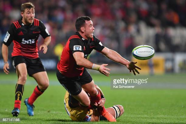Ryan Crotty of the Crusaders offloads the ball during the round five Super Rugby match between the Crusaders and the Force at AMI Stadium on March 24...
