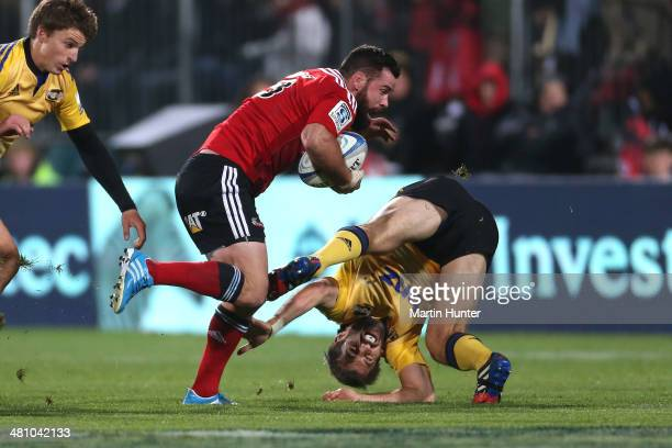 Ryan Crotty of the Crusaders pushes away Conrad Smith of the Hurricanes during the round seven Super Rugby match between the Crusaders and the...