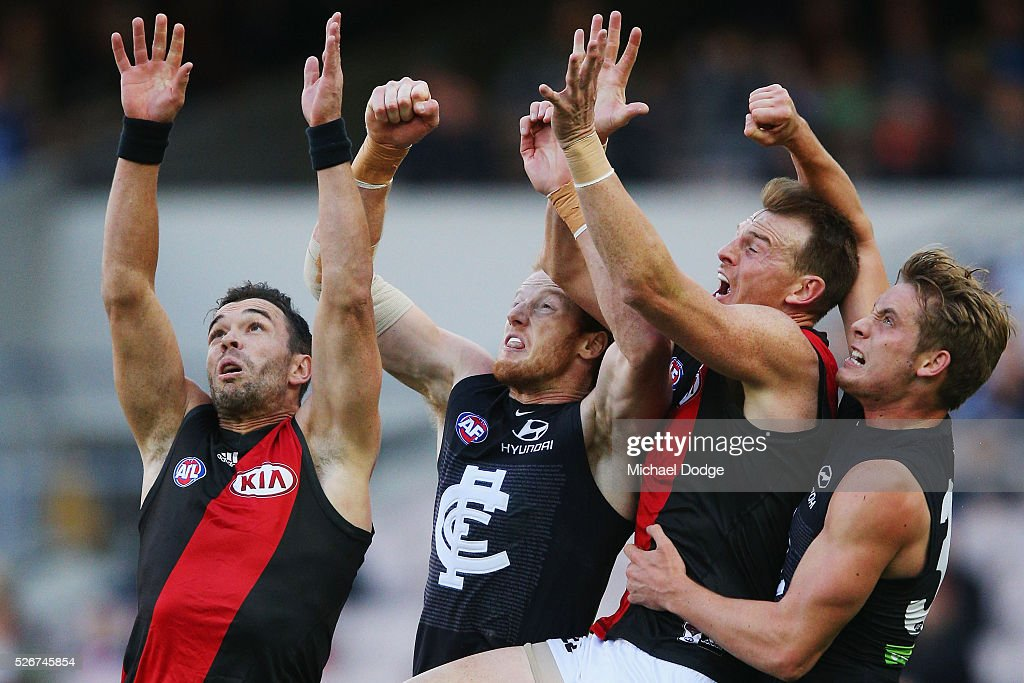Ryan Crowley of the Bombers (L) compete for the ball next to teammate Brendon Goddard and Andrew Phillips and Ciaran Byrne (R) of the Blues during the round six AFL match between the Carlton Blues and the Essendon Bombers at Melbourne Cricket Ground on May 1, 2016 in Melbourne, Australia.
