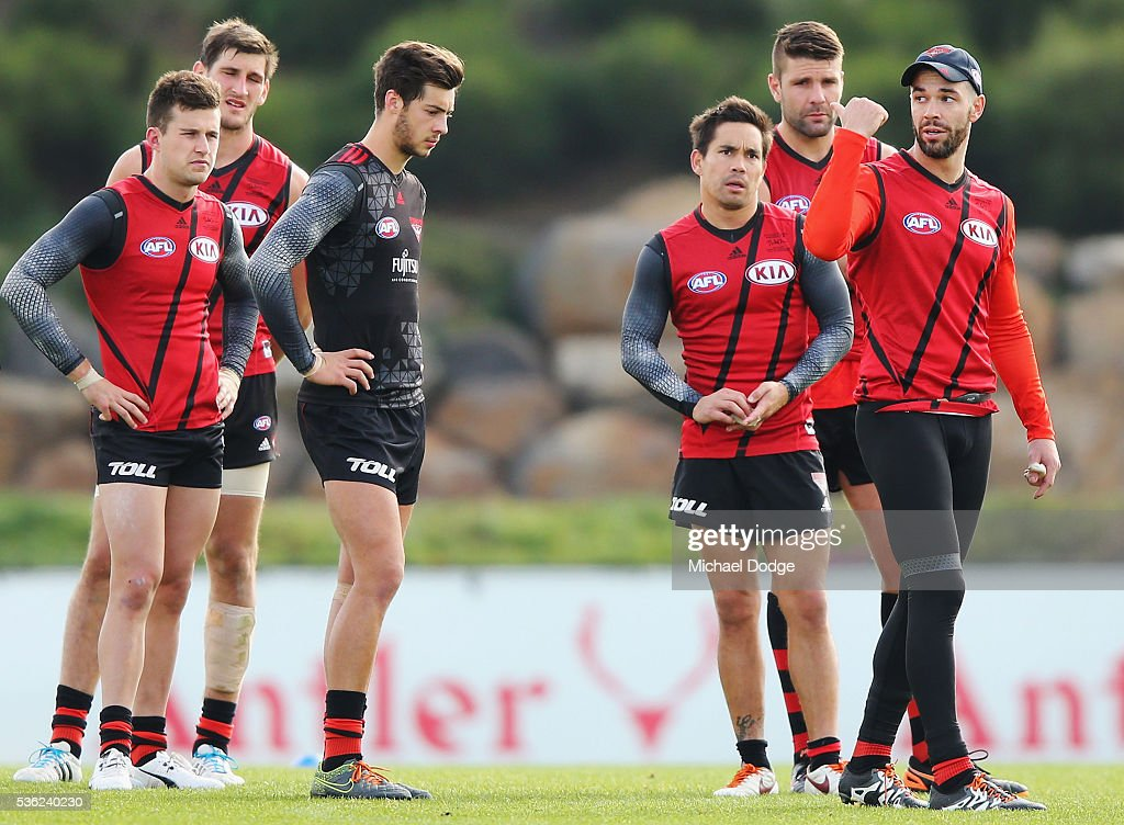 Ryan Crowley of the Bombers gives advice to teammates during an Essendon Bombers AFL training session at True Value Solar Centre on June 1, 2016 in Melbourne, Australia.