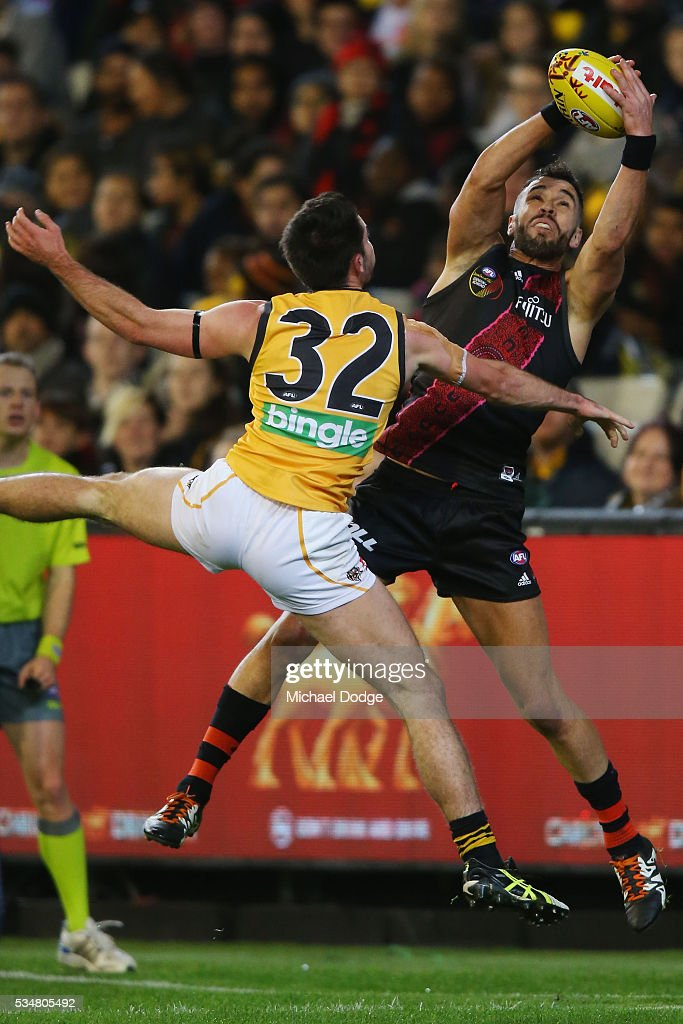 Ryan Crowley of the Bombers marks the ball against Corey Ellis of the Tigers during the round 10 AFL match between the Essendon Bombers and the Richmond Tigers at Melbourne Cricket Ground on May 28, 2016 in Melbourne, Australia.