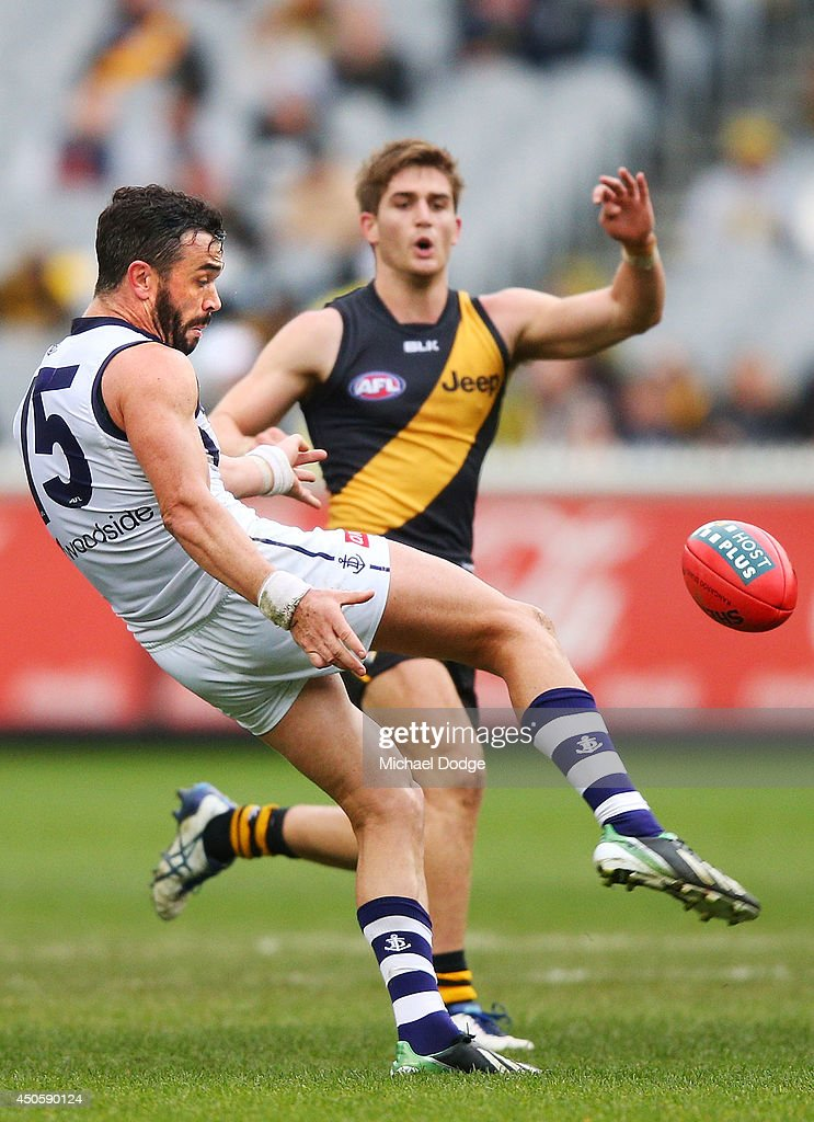 Ryan Crowley of the Dockers kicks the ball during the round 13 AFL match between the Richmond Tigers and the Fremantle Dockers at Melbourne Cricket Ground on June 14, 2014 in Melbourne, Australia.