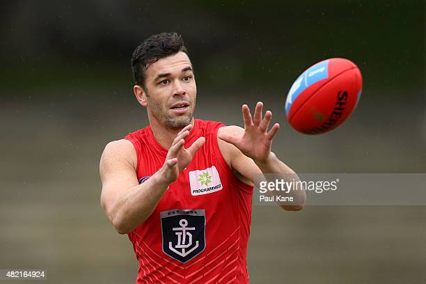 Ryan Crowley of the Dockers works on some drills during a Fremantle Dockers AFL training session at Fremantle Oval on July 28 2015 in Fremantle...