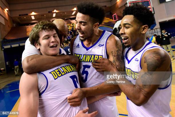 Ryan Daly is celebrated after hitting the gamewinning basket against the Drexel Dragons by teammates Barnett Harris Eric Carter and Anthony Mosley of...
