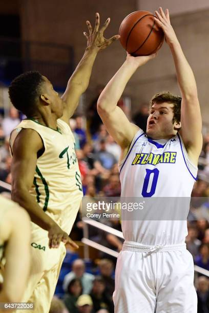 Ryan Daly of the Delaware Fightin Blue Hens shoots the ball against Daniel Dixon of the William Mary Tribe during the first half at the Bob Carpenter...