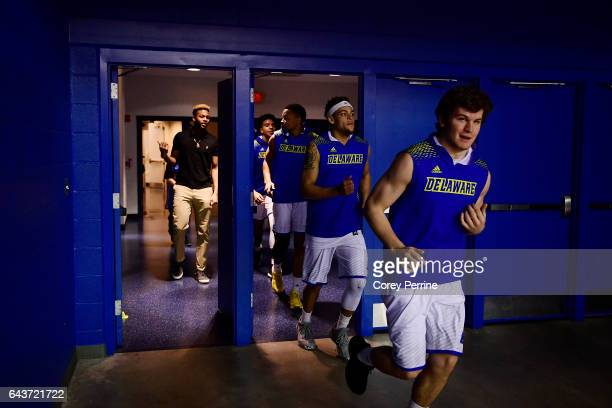 Ryan Daly runs out follow by teammate Darian Bryant of the Delaware Fightin Blue Hens as they take to the floor at the Bob Carpenter Center on...