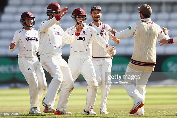 Ryan Davies the wicketkeeper of Somerset celebrates with Marcus Trescothick Lewis Gregory and Peter Trego after running out Tom Moores during day...