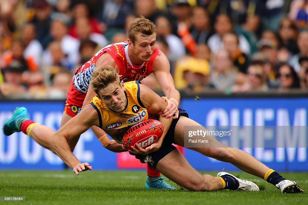 Ryan Davis of the Suns tackles Brad Sheppard of the Eagles during the round 10 AFL match between the West Coast Eagles and the Gold Coast Suns at Domain Stadium on May 29, 2016 in Perth, Australia.