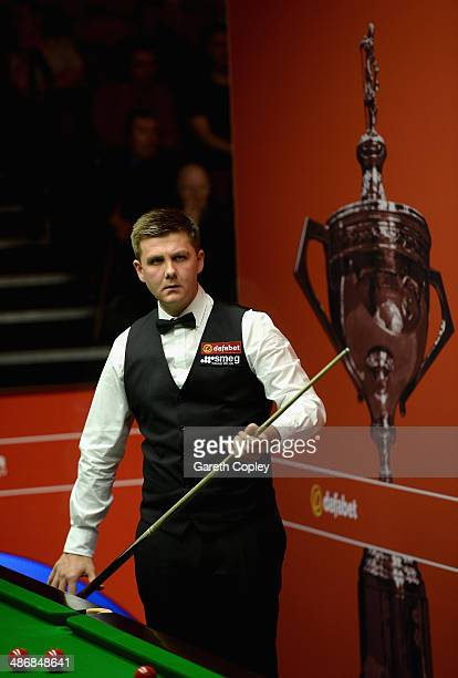 Ryan Day lines up a shot against Judd Trump during their second round match in The Dafabet World Snooker Championship at Crucible Theatre on April 26...