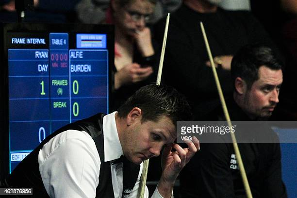 Ryan Day of Great Britain and Alfie Burden of Great Britain react during their match on day three of the 2015 German Masters at Tempodrom on February...