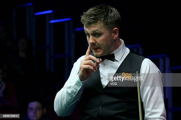 Ryan Day of UK eyes the ball against Mark J Williams of UK during day two of the 2015 Snooker World Grand Prix at Venue Cymru on March 17 2015 in...