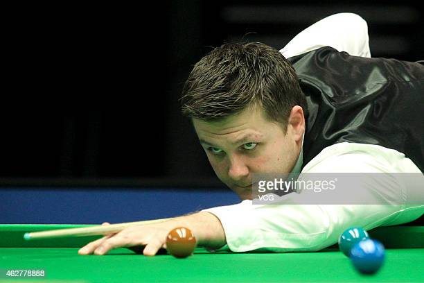 Ryan Day of UK plays a shot against Ding Junhui of China on day two of the 2015 German Masters at Tempodrom on February 5 2015 in Berlin Germany