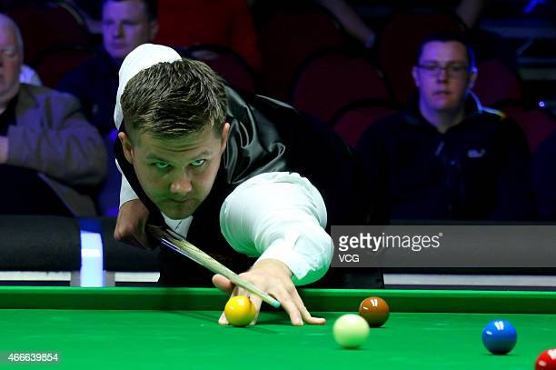 Ryan Day of UK plays a shot against Mark J Williams of UK during day two of the 2015 Snooker World Grand Prix at Venue Cymru on March 17 2015 in...