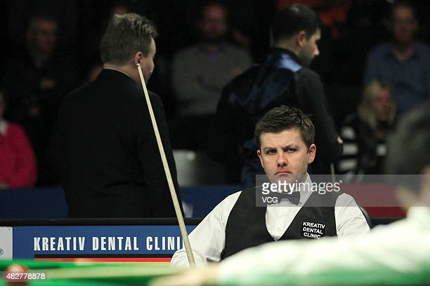 Ryan Day of UK waits for his shot against Ding Junhui of China on day two of the 2015 German Masters at Tempodrom on February 5 2015 in Berlin Germany