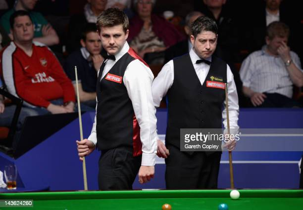 Ryan Day of Wales and Matthew Stevens of Wales during their quarter final match during the Betfredcom World Snooker Championship at Crucible Theatre...