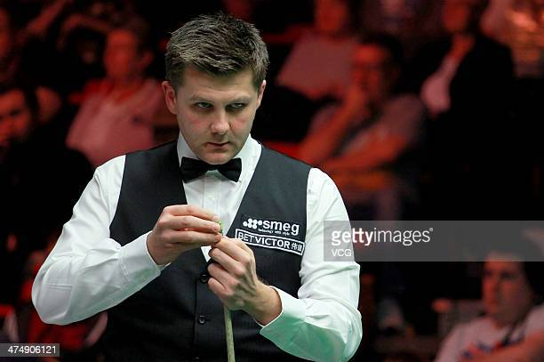 Ryan Day of Wales chalks his cue against Anthony McGill of Scotland on day seven of The Welsh Open at the Newport Centre on February 25 2014 in...