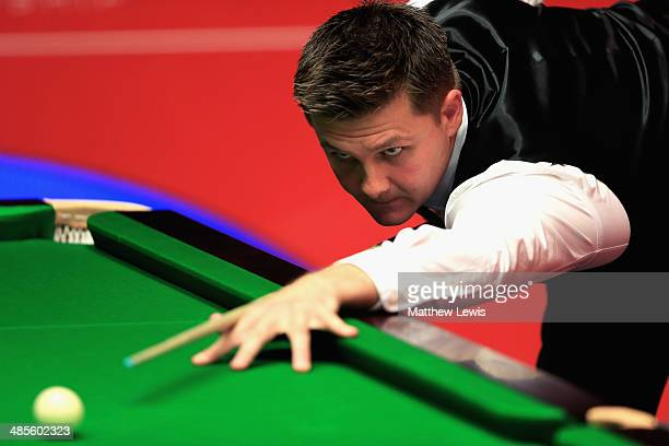Ryan Day of Wales in actino against Stephen Maguire of Scotland during day one of the The Dafabet World Snooker Championship at Crucible Theatre on...