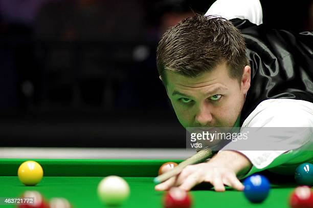 Ryan Day of Wales plays a shot against Noppon Saengkham of Thailand during day two of 2015 BetVictor Welsh Open February 17 2015 in Cardiff Wales