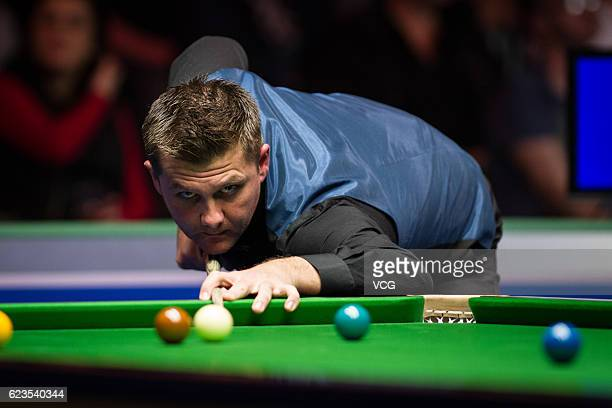 Ryan Day of Wales plays a shot during the first round match against Marco Fu of Chinese Hong Kong on day two of Coral Northern Ireland Open 2016 at...