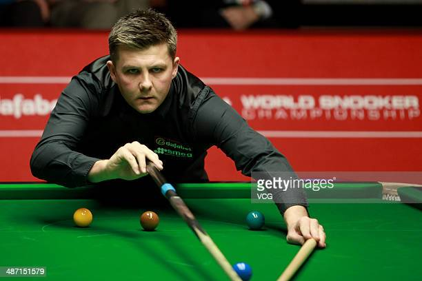 Ryan Day of Wales plays a shot during the match against Judd Trump of England on day nine of the Dafabet World Snooker Championship at Crucible...