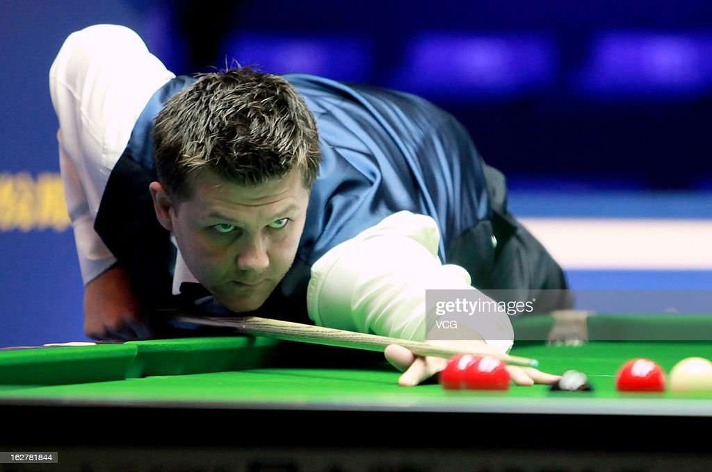 Ryan Day of Wales plays a shot during the match against Mark Allen of Northern Ireland on day Two of the 2013 World Snooker Haikou Open at Haikou Convention & Exhibition Center on February 26, 2013 in Haikou, Hainan Province of China.