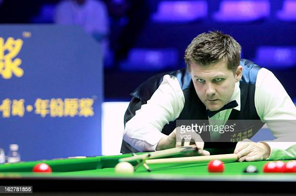 Ryan Day of Wales plays a shot during the match against Mark Allen of Northern Ireland on day Two of the 2013 World Snooker Haikou Open at Haikou...
