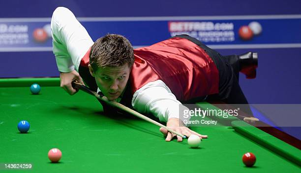 Ryan Day of Wales plays a shot in his quarter final match against Matthew Stevens of Wales during the Betfredcom World Snooker Championship at...
