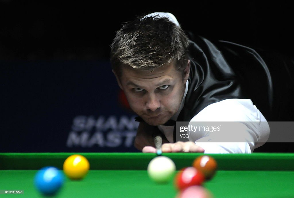 Ryan Day of Wales plays a shot in the match against Barry Hawkins of England on day four of the 2013 World Snooker Shanghai Master at Shanghai Grand Stage on September 19, 2013 in Shanghai, China.