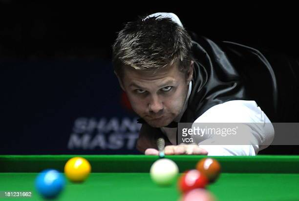 Ryan Day of Wales plays a shot in the match against Barry Hawkins of England on day four of the 2013 World Snooker Shanghai Master at Shanghai Grand...