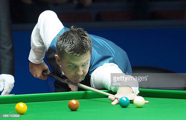 Ryan Day of Wales plays a shot in the match against Ding Junhui of China during day four of the Shanghai Masters 2015 at Shanghai Grand Stage on...