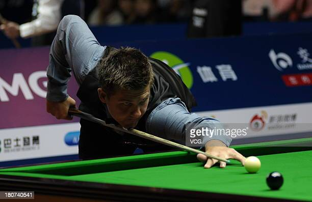 Ryan Day of Wales plays a shot in the match against Lu Ning of China on day 1 of the 2013 World Snooker Shanghai Masters at Shanghai Grand Stage on...