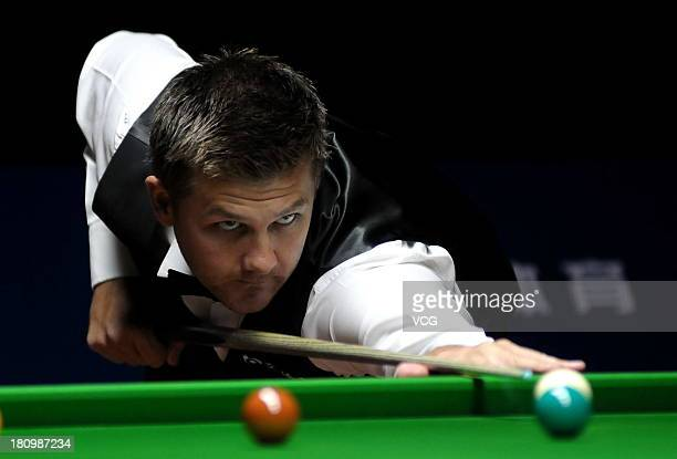 Ryan Day of Wales plays a shot in the match against Mark Allen of Northern Ireland on day three of the 2013 World Snooker Shanghai Master at Shanghai...
