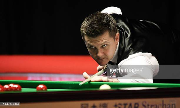 Ryan Day of Wales plays a shot in the second round match against John Higgins of Scotland on day three of the Ladbrokes World Grand Prix at Venue...